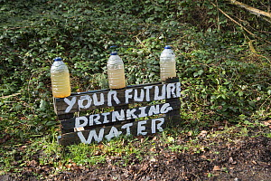 Bottles of dirty water at oil drilling and fracking protest camp, Leith Hill, Surrey, UK. March, 2017  -  Adrian Davies