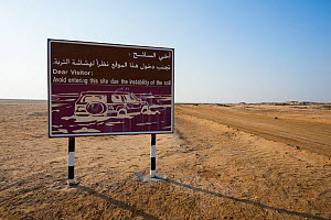 Sign warning about the danger of soft, mixed mud-salt-flats, locally known as 'sabkhas', Bar Al Hikman , Sultanate of Oman, February. - Martin Gabriel