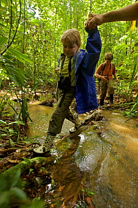 Jessica Laman walking other creek, with brother Russell Laman behind, Gunung Palung National Park, Borneo. August 2010 Model released. - Tim  Laman