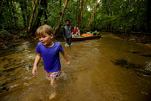 Jessica Laman wading in river with her mother Cheryl Knott  in boat on trip up to Cabang Panti Research Station, Gunung Palung National Park, Borneo. August 2010  -  Tim  Laman