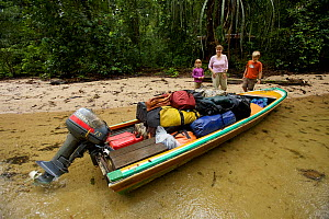Orangutan researcher Cheryl Knott, with children Russell and Jessica, with loaded boat, ready to depart from Cabang Panti Research Station, Gunung Palung National Park, Borneo. August 2010 Model relea...  -  Tim  Laman