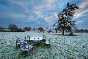 Garden table at dawn covered in frost, Shropshire, England, December 2014.  -  David Noton