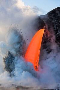 Hot lava from the 61G flow from Kilauea Volcano entering the ocean from the open end of a lava tube at the Kamokuna entry in Hawaii Volcanoes National Park, producing steam explosions, Kalapana, Puna,...  -  Doug Perrine