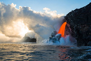 Hot lava from the 61G flow from Kilauea Volcano entering the Pacific Ocean from the open end of a lava tube at the Kamokuna entry in Hawaii Volcanoes National Park, producing steam explosions, Kalapan...  -  Doug Perrine