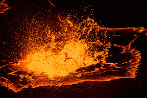 Molten lava boiling in a lava lake in a pit below the crater floor of Halemaumau Crater, Kilauea Volcano, Hawaii. May 2015.  -  Doug Perrine