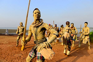 Men with skin coloured with sand participating in traditional dance, Bolama Island, Bijagos UNESCO Biosphere Reserve, Guinea Bissau, February 2015. - Enrique Lopez-Tapia