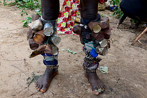 Legs of participant in carnival, covered with tin cans, Eticoga, Orango Island, Bijagos UNESCO Biosphere Reserve, Guinea Bissau, February 2015.  -  Enrique Lopez-Tapia