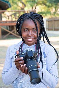 Pupil Tharollo Shaai with DSLR camera during residential photography course organised by Wild Shots Outreach. Kruger National Park, South Africa, June 2017.  -  Wild Shots Outreach