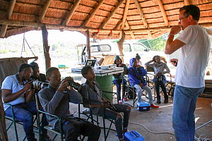 Mike Kendrick talking to pupils during residential photography course organised by Wild Shots Outreach. Kruger National Park, South Africa, June 2017.  -  Wild Shots Outreach