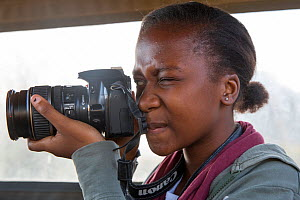 Pupil Evelyn Lekanyane with camera during residential photography course organised by Wild Shots Outreach. Kruger National Park, South Africa, June 2017.  -  Wild Shots Outreach