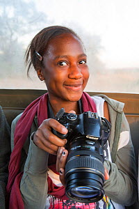 Pupil Evelyn Lekanyane with camera during residential photography course organised by Wild Shots Outreach. Kruger National Park, South Africa, June 2017,  -  Wild Shots Outreach