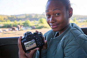 Pupil Prisence Mashaba showing the photo she has just taken on the back of her camera, during residential photography course organised by Wild Shots Outreach. Kruger National Park, South Africa, June.  -  Wild Shots Outreach