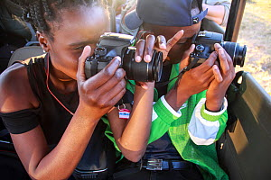Students taking pictures during residential photography course organised by Wild Shots Outreach. Kruger National Park, South Africa, June.  -  Wild Shots Outreach