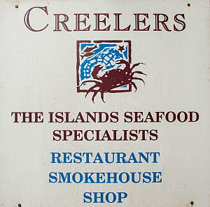 Sign for 'The islands seafood specialists' restaurant, smokehouse and shop, Isle of Arran, with produce from South Arran Marine Protected Area, Scotland, UK, August 2016.  -  SCOTLAND: The Big Picture