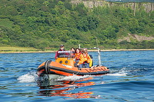 Five people aboard tourist boat in waters south of the Isle of Arran, Lamlash Bay, Isle of Arran, South Arran Marine Protected Area, Scotland, UK, August. - SCOTLAND: The Big Picture