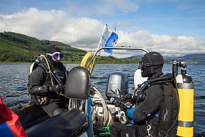 Two divers undertaking their final checks on dive boat, Lamlash Bay, Isle of Arran, South Arran Marine Protected Area, Scotland, UK, August 2016.  -  SCOTLAND: The Big Picture