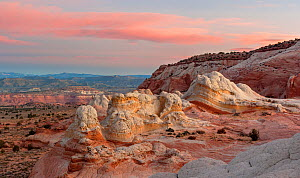 Petrified sand dune sandstone formations with eroded stratified patterns, looking into the Vermilion Cliffs National Monument, Arizona, USA. November.  -  Jack Dykinga