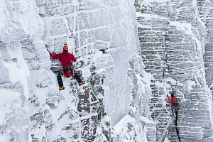 Climbers on vertical rock face in winter, Northern Corries, Cairngorms National Park, Scotland, UK, December 2015. - SCOTLAND: The Big Picture