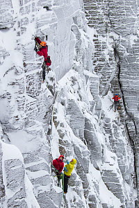 Climbers in red jackets on vertical rock face in winter, Northern Corries, Cairngorms National Park, Scotland, UK, December 2015. - SCOTLAND: The Big Picture