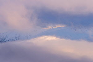 Beinn na Caillich poking through the low cloud at sunrise from Meall Dearg, Glencoe, Scotland, UK, February 2017.  -  SCOTLAND: The Big Picture