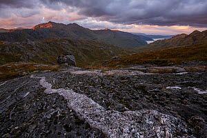 Quartzite band in bedrock in mountains at sunrise with view to loch, Lochaber, Scotland, UK, October 2016.  -  SCOTLAND: The Big Picture