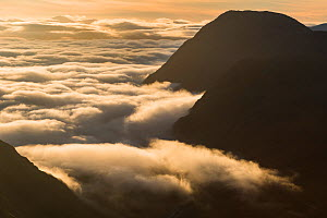 An inversion over Rannoch Moor spilling into Glen Coe. Buachaille Etive mor and Buachaille Etive Beag visible through sea of cloud, Lochaber, Scotland, UK, September 2016.  -  SCOTLAND: The Big Picture
