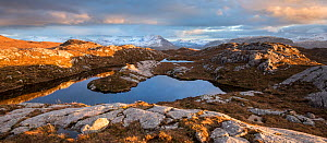Remote hill lochan with view towards Loch Torridon and Ben Damph, in late winter light, Wester Ross, Scotland, UK, March  2017 - SCOTLAND: The Big Picture