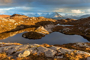 Remote hill lochan with view towards Loch Torridon and Ben Damph, Wester Ross, Scotland, UK, March  2017 - SCOTLAND: The Big Picture