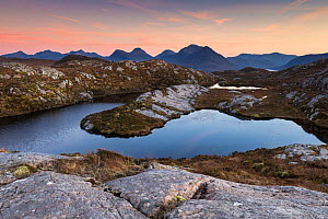Sunset over remote hill lochan overlooking Loch Torridon to Ben Damph, Wester Ross, Scotland, UK, January  -  SCOTLAND: The Big Picture