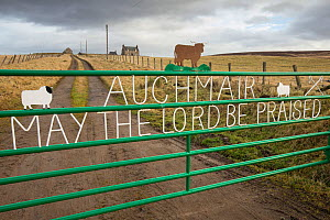 Religious message on farm gate with croft in background, Aberdeenshire, Scotland, UK, January 2017  -  SCOTLAND: The Big Picture