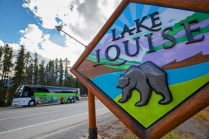 Location sign for Lake Louise featuring a grizzly bear, Lake Louise, Banff National Park, Alberta, Canada, June  -  SCOTLAND: The Big Picture