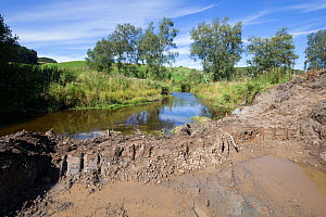 Excavation works being carried out along river as part of re-naturalisation of river course to reduce flooding. Part of Eddleston Water Project led by Tweed Forum, Peebles, Tweeddale, Scotland, UK, Ju... - SCOTLAND: The Big Picture