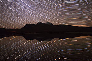 Star trails over Cul Mor reflected in water, Assynt, Sutherland, Scotland  -  SCOTLAND: The Big Picture