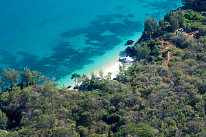 Aerial view of coastal landscape and beach surrounded by dry deciduous forest at Anjajavy Private Reserve. After hours of flying from Antananarivo this was one of the very few areas with some forest l...  -  David  Pattyn