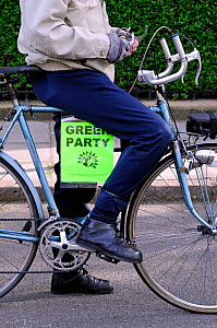 Green Party poster on bike ridden by activist, General Election 2015, Highbury, Islington North Constituency, London England Britain UK, May 2015.  -  Pat  Tuson