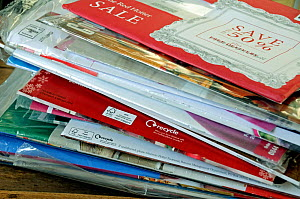 Pile of unopened envelopes containing clothing catalogues and showing recycle logo London, UK, January 2015. - Pat  Tuson