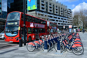 Santander Cycles or Boris Bikes, bicycle hire scheme docking station with number 29 bus, corner of Hampstead Road and Euston Road, Camden, England, UK, March 2016.  -  Pat  Tuson