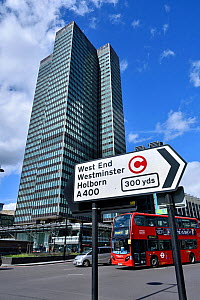 Traffic direction sign with congestion charge symbol, bus and Euston Tower in background, Euston Road, Central London, UK, March 2016.  -  Pat  Tuson