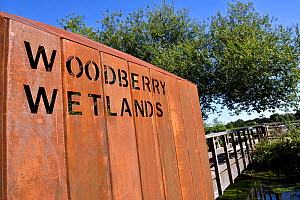 Woodberry Wetlands sign punched on side of rusted iron architecture entrance to urban nature reserve via bridge over New River, formally Stoke Newington Reservoir, Hackney, London, England UK - Pat  Tuson