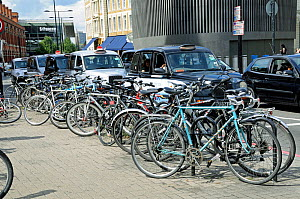 Bike racks and taxies with St Pancras Station behind London, England, UK,  August 2014.  -  Pat  Tuson