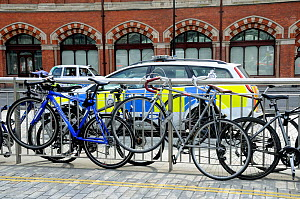 Bikes attached to railings showing the need for more bicycle racks in the vacinity of the station, Kings Cross, London, England, UK, August 2014.  -  Pat  Tuson