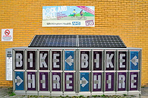 Brompton Bike Dock, lockers holding Brompton folding bicycles for hire outside the Whittington Hospital. The solar panels above provide all the energy needed to power the Dock. Islington, England, UK,...  -  Pat  Tuson
