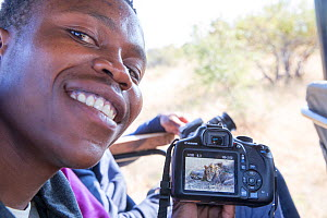 Student showing picture taken of Lion (Panthera leo) during Wild Shots Outreach Course.  Timbavati Game Reserve, Limpopo Province, South Africa  -  Wild Shots Outreach