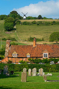 Turville Village with gravestones and in the distance, Cobstone windmil, The Chilterns, Buckinghamshire, England, UK. September 2016.  -  Gary  K. Smith