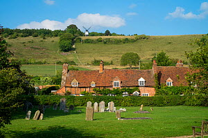 Turville Village showing the gravestones and Cobstone windmill in th distance, The Chilterns, Buckinghamshire, England, UK. September 2016.  -  Gary  K. Smith