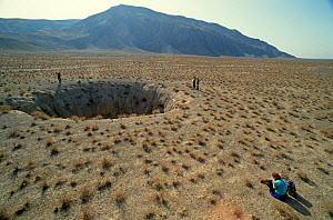 Sinkhole on the Kugitang plain, Turkmenistan, 1990. Small repro only.  -  Willem  Kolvoort