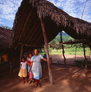 Mother and daughters and home in Campo village of Agua Caliente.  Sierra Alamos, Mexico 1992 - Jack Dykinga