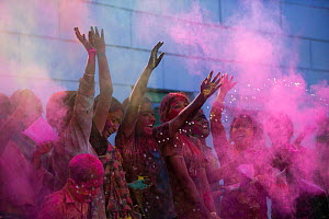 Children throwing coloured powder during Holi festival,  Jodhpur, Rajasthan, India. March 2015  -  Mark MacEwen