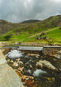 Hydroelectric generation system on the Afon (River) Cwm Llan close to the Watkin Path up Mount Snowdon, Snowdonia National Park, North Wales, UK, June 2017. - Alan  Williams