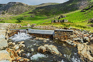 Hydroelectric generation system on the Afon (River) Cwm Llan close to the Watkin Path up Mount Snowdon Snowdonia National Park, North Wales, UK, June 2017.  -  Alan  Williams